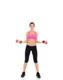 Metta in mostra la donna di forma fisica Immagine Stock