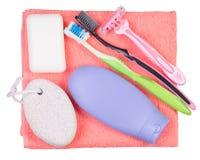Metta per l'asciugamano degli spazzolini da denti del rasoio della lozione della crema del sapone da bagno Fotografie Stock