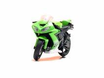 Mette in mostra il giocattolo del motociclo, parcheggiato su un fondo trasparente 4 fotografia stock libera da diritti