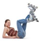 Mette in mostra la ragazza con i pattini di rullo fotografia stock