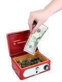 Mettendo soldi assenti Fotografia Stock Libera da Diritti