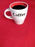 Mettez en forme de tasse complètement du café Photos libres de droits