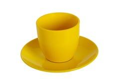 mettez en forme de tasse le jaune de thé de soucoupe Photo stock