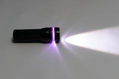 Mettez en marche la lampe-torche images stock