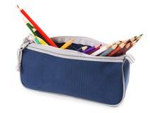 Mettez en sac avec des outils d'école sur un fond blanc Images libres de droits