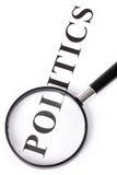 Mettez la politique et la loupe en vedette Images stock
