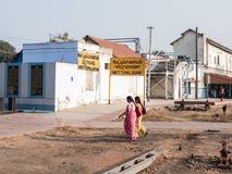 Indian women walking near a train station. Mettupalayam, Kerala, India.  01/08/2018. women walking near the Mettupalayam train station Stock Photography