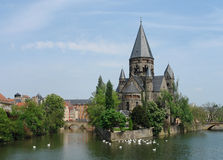 Metz Church. The Moselle river flows around an old romanesque church in Metz in the Lorraine region of France Stock Photos