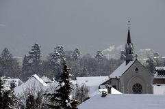 Metz-Tessy french village and church under snow, France Stock Images