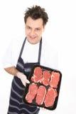 Metzger mit zartem Steak Lizenzfreie Stockfotos