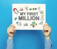Meu primeiro milhão textos em um cartaz branco Fotografia de Stock Royalty Free