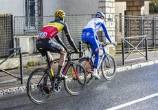 Two Cyclists - Paris-Nice 2018 stock images