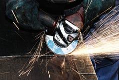 Meulage d'ouvrier Photos stock