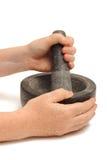 Meulage de pilon et de mortier Photo stock