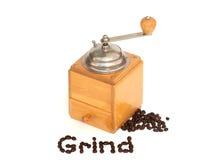 Meulez le mot et les grains de café avec la rectifieuse sur le blanc image libre de droits