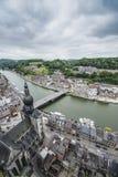 Meuse River passing through Dinant, Belgium. Stock Photos