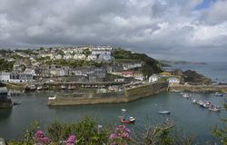 Mevagissey Harbour and View of St. Austell Beach in Cornwall. Mevagissey, the Harbour and View of St. Austell Beach in Cornwall Royalty Free Stock Photography