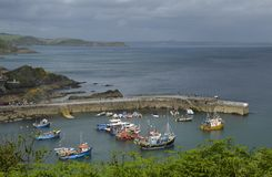 Mevagissey Outer Harbour and St. Austell Bay in Cornwall. The Picturesque Harbour of the Quaint Town of Mevagissey and St. Austell Bay in Cornwall Stock Image