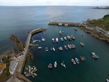 Mevergissey Fishing Harbor. In Cornwall South West England. This is an Arial shot taken by a DJI Inspire 1 Drone. All the fishing boats are moored up after a royalty free stock photos