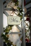 MEVR.teken op huwelijksboog Stock Foto