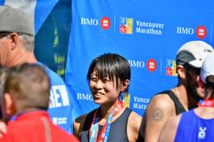 MEVROUW Yuko Mizuguchi won vrouwelijke 1st plaats in Vancouver maraton stock fotografie