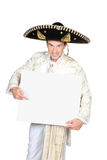 Mexican. Man pointing at a sign stock photo