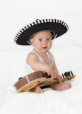 Mexican. The little boy in a sombrero with a guitar on a white background Stock Photography