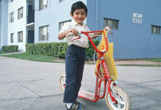 A Mexican-American boy. With his scooter, East Los Angeles, CA Royalty Free Stock Image