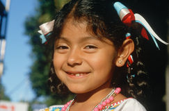 A Mexican-American girl with ribbons in her hair Royalty Free Stock Photography