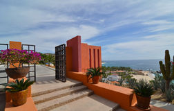 Mexican Architecture. Colorful gate with view of the sea of Cortez stock photos