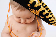 Mexican baby. 6 month old baby boy wearing a Mexican hat Royalty Free Stock Image