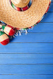Mexican background sombrero blue wood copy space vertical Stock Photo