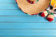 Mexico, Mexican sombrero, maracas, wood background, copy space. Mexican sombrero and maracas with traditional serape blanket laid on an old blue painted pine stock photography