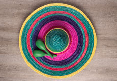 Mexican background with sombrero and maracas royalty free stock image