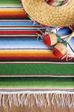 Mexico, Mexican sombrero background, blanket, maracas, copy space vertical. Mexican background with sombrero straw hat, maracas and traditional serape blanket or Stock Photography