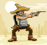 Mexican bandit with gun in prairie Stock Photography