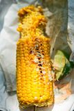 Mexican barbecued corn on the knob with Harissa mayo and lime. Salt and pepper Stock Photos