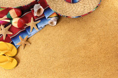 Mexican beach background. With sombrero straw hat, traditional serape blanket, starfish, seashells and maracas.  Space for copy Stock Image