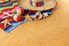 Mexican beach background, sombrero, copy space. Mexican beach background with sombrero straw hat, traditional serape blanket, starfish, seashells and maracas Stock Photography