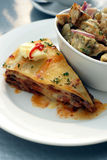 Mexican Bean Slice. Mexican Bean and Pasta Slice with Kumara or Sweet Potato salad Stock Image
