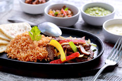 Mexican beef fajitas with flour tortillas and rice. Close up portrait of mexican beef fajitas with flour tortillas and rice Stock Image