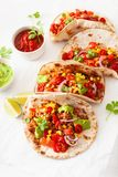 Mexican beef and pork tacos with salsa, guacamole and vegetables stock photography