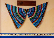 Mexican blaket/sarape festive decoration on the wall. Mexican culture. Royalty Free Stock Photo