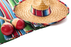 Mexico, Mexican sombrero maracas and blanket isolated on white background. Traditional Mexican serape blanket or rug with sombrero and maracas isolated against a Stock Images