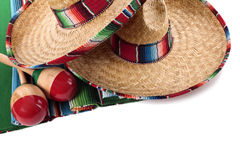 Mexico, Mexican sombrero blanket maracas isolated white background Stock Photo