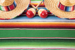 Mexico Mexican blanket background sombreros maracas copy space. Mexican sombreros and maracas on a traditional serape blanket.  Space for copy Royalty Free Stock Photos