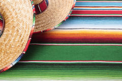 Mexico mexican blanket background sombrero copy space. Mexican sombreros and traditional serape blanket.  Space for copy Royalty Free Stock Images