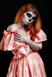 Mexican body art. God of death. Redhead girl in peachy dress. Woman monster. Creative dark make-up. Stock Photos