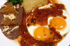 Mexican breakfast. With over easy eggs, with hot tomato sauce and fried beans Stock Photo