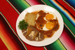 Mexican breakfast. With ranch eggs, with hot tomato sauce and fried beans Stock Images